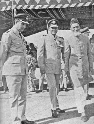 Air Cdre Dogar (Retd) being escorted by Gp Capt Masood Khan and Air Cdre E G Hall, during a Squadron Colour Award ceremony of No 6 Sqn, Chaklala. - FearlessWarriors.PK