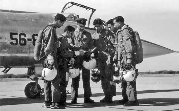 Flt Lt Alauddin Ahmed (2nd from left) briefing a group of fighter pilots, moments before proceeding on a training mission on Star Fighter - FearlessWarriors.PK