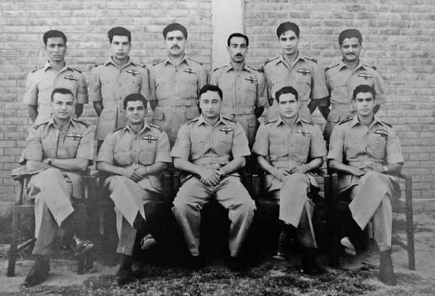 Flt Lt Alauddin Ahmed sitting 2nd from left and Sqn Ldr Sadruddin Sqn Cdr in centre along with a group of No 9 sqn fighter pilots at PAF Base Sargodha. - FearlessWarriors.PK