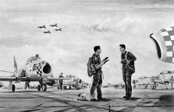 Wg Cdr Masud giving last minute briefing to Flt Lt Hameed Anwar before proceeding on a practice mission of 'Falcons' aerobatic team at Mauripur 1958 - FearlessWarriors.PK