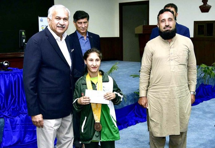Air Chief Marshal Mujahid Anwar Khan, Chief of the Air Staff, Pakistan Air Force awarding cash prize to Sabrina Touhid who won 01 bronze medal in Futsal in Special Olympics 2019 held at Abu Dhabi.